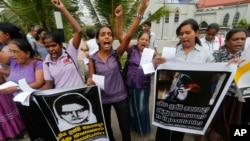 FILE - Sri Lankan women shout slogans during a protest in Colombo, Sri Lanka, Jan. 11, 2013, condemning the execution of Sri Lankan domestic worker Rizana Nafeek in Saudi Arabia. (AP Photo/Eranga Jayawardena)