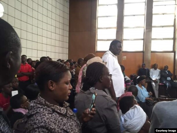 Some Zimbabweans attending a court case in which 67 activists are facing charges of engaging in alleged violent activities.