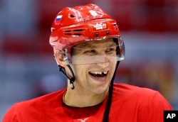 Russia forward Alex Ovechkin laughs with teammates during a training session at the 2014 Winter Olympics, Feb. 10, 2014, in Sochi, Russia.