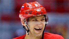 Russia forward Alexander Ovechkin laughs with teammates during a training session at the 2014 Winter Olympics, Feb. 10, 2014, in Sochi, Russia.