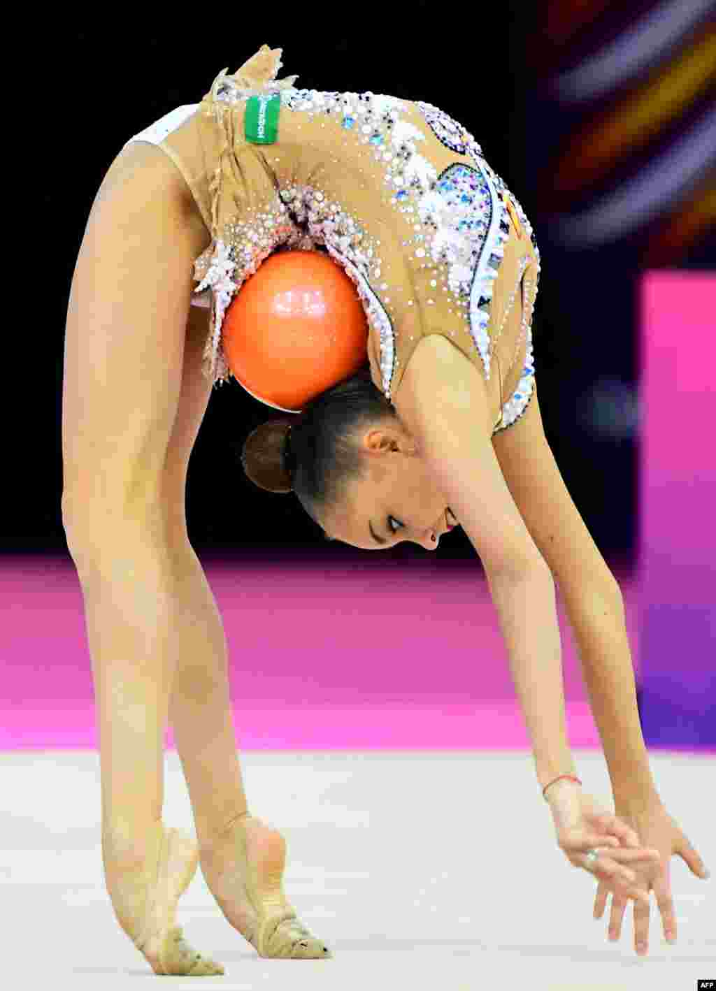 Gold medalist, Russia's Arina Averina performs with her ball in Papp Laszlo Arena of Budapest, Hungary, during the apparatus final day of 33rd European Rythmic Gymnastic Championships.