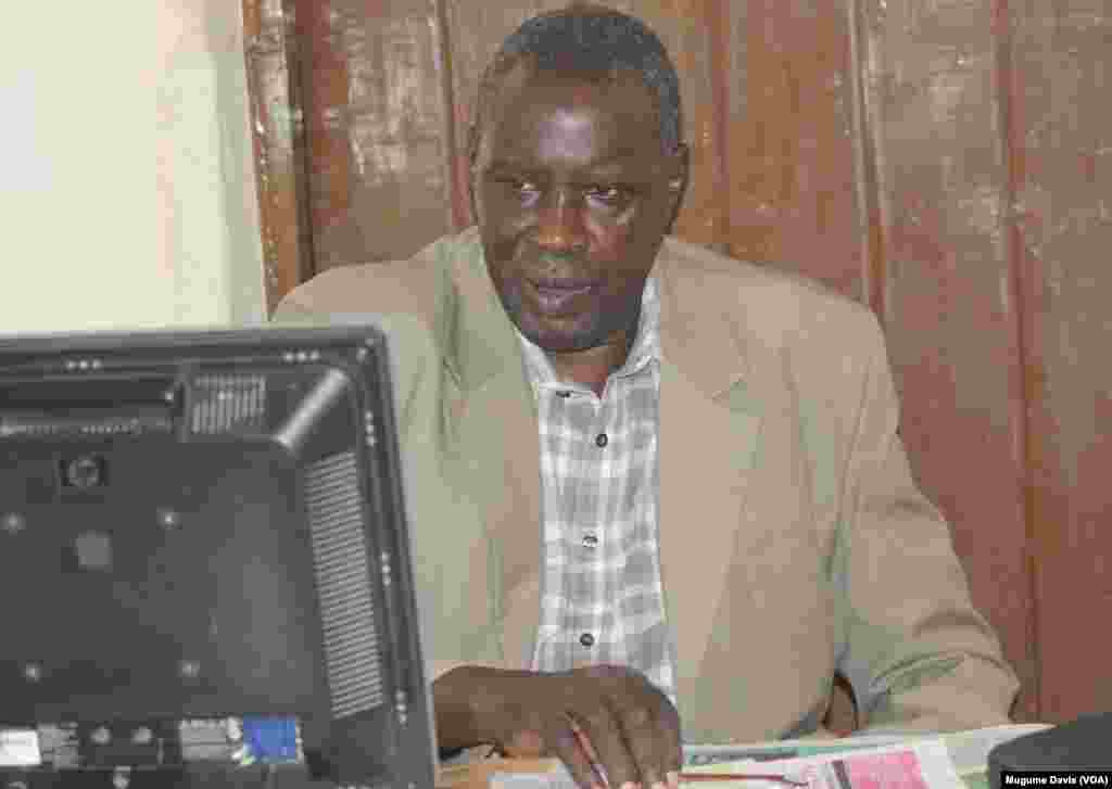 South Sudanese journalist Alfred Taban at his desk at The Juba Monitor. Taban says he was detained by police and is being sued by the former governor of Lakes state after publishing an editorial that was critical of him. (VOA/Mugume Davis)
