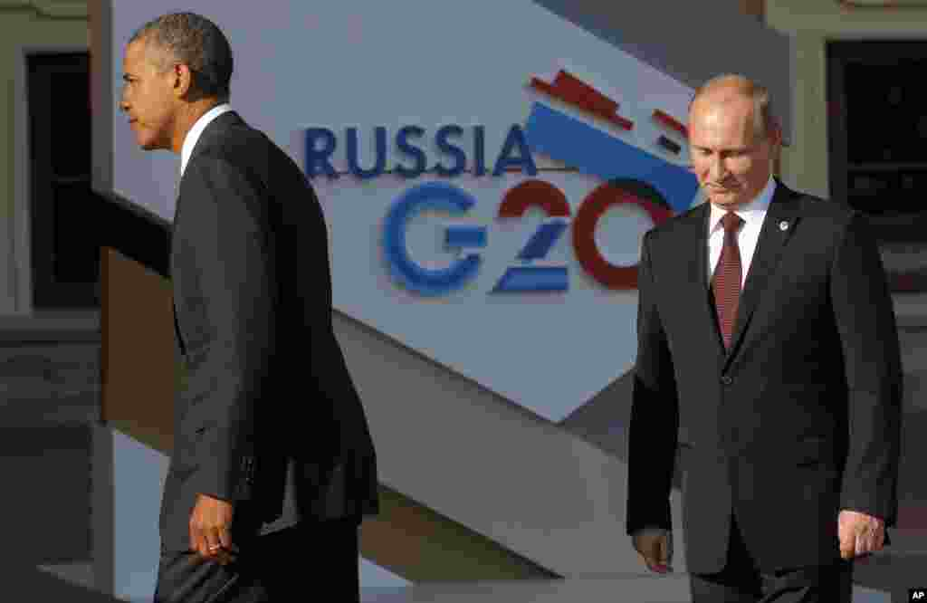 U.S. President Barack Obama walks away after shaking hands with Russia's President Vladimir Putin during arrivals for the G20 Summit at the Konstantin Palace in St. Petersburg, Sept. 5, 2013.