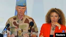 Norwegian Major General Robert Mood (L), chief of the United Nations Supervision Mission in Syria, addresses a news conference in Damascus next to spokeswoman Sawsan Ghoshe, July 5, 2012.
