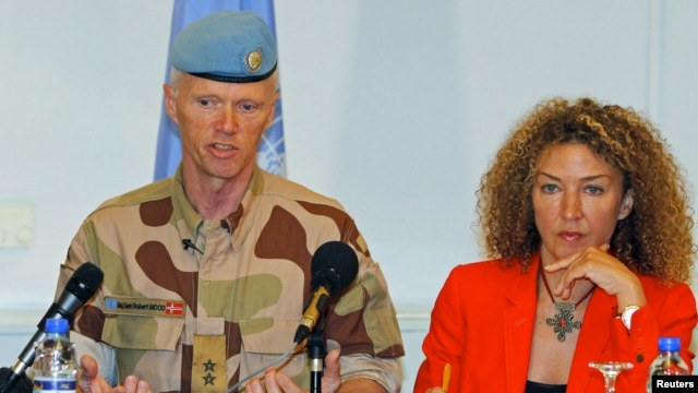 Major General Robert Mood (L), chief of the UN Supervision Mission in Syria (UNSMIS), addresses a news conference in Damascus, next to his spokeswoman Sawsan Ghoshe, July 5, 2012.