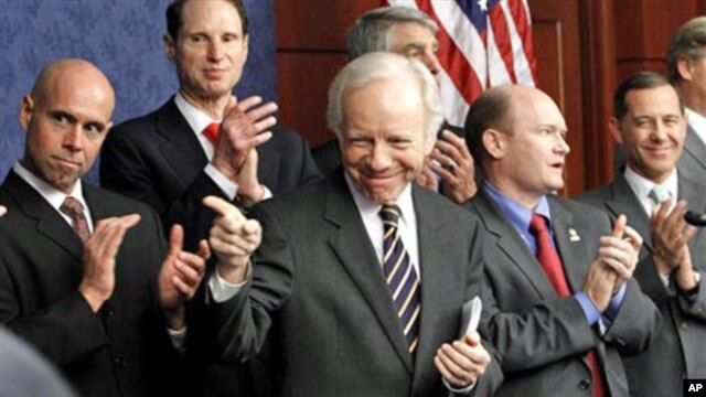 Senator Joseph Lieberman, center, gestures during a news conference pushing for the repeal of the military 'Don't Ask Don't Tell' rule, Capitol Hill, Washington, DC, 18 November 2010