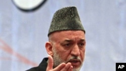 Afghan President Hamid Karzai speaks during a teachers' graduation ceremony in Kabul March 30, 2011.