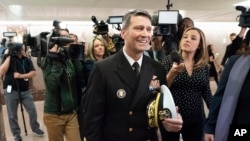 Rear Adm. Ronny Jackson, President Donald Trump's choice to be secretary of the Department of Veterans Affairs, leaves a Senate office building after meeting individually with some members of the committee that would vet him for the post, on Capitol Hill