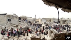 People searching the rubble after a missile attack by Syrian government forces in Aleppo, Syria. (Feb. 26, 2013)