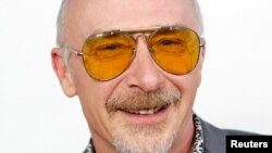 """Singer Graham Parker arrives at the premiere of """"This is 40,"""" Grauman's Chinese Theatre in Hollywood, California, Dec. 12, 2012."""
