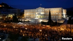Demonstrators protest in front of parliament, Athens, July 17, 2013.