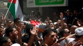 Men carry the body of one of the Palestinians shot dead by Israeli troops at Qalandiya Refugee Camp in the West Bank August 26, 2013.
