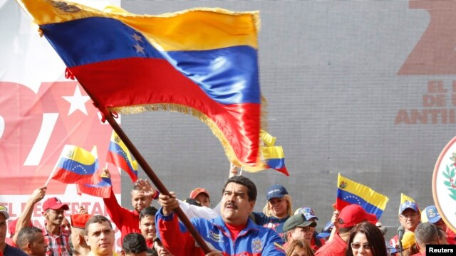 This Venezuelan government photo shows President Nicolas Maduro waving a flag to celebrate the anniversary of the