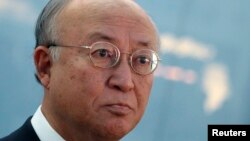 International Atomic Energy Agency (IAEA) Director General Yukiya Amano talks to journalists after arriving at the Vienna International Airport in Schwechat, Nov. 12, 2013.