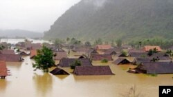 Homes are inundated in Vietnam's Tan Hoa commune, in the central province of Quang Binh, October 2, 2011. Vietnam is also facing serious flooding in its southern Mekong Delta region where thousands of houses and thousands of hectares of rice fields are i