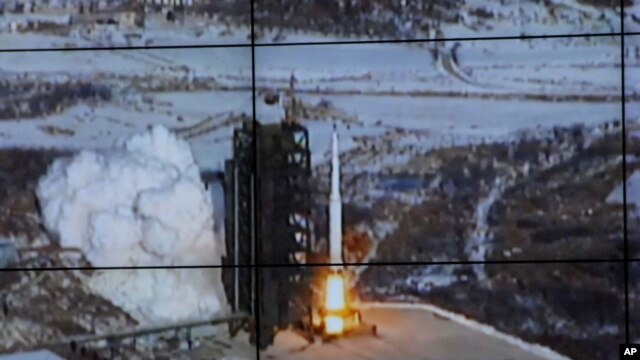 Image taken and released by the Korean Central News Agency and distributed in Tokyo by the Korea News Service, the Unha-3 rocket lifts off from a launch site on the west coast, in the village of Tongchang-ri, about 56 kilometers (35 miles) from the Chines