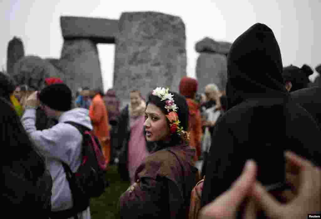 Revellers celebrate the summer solstice at the ancient Stonehenge monument on Salisbury Plain in southern England. Druids, a pagan religious order dating back to Celtic Britain, believe Stonehenge was a center of spiritualism more than 2,000 years ago.