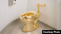 The Guggenheim Museum in New York has installed an 18-carat, solid gold toilet that patrons can use. (Guggenheim)
