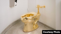 FILE - The Guggenheim Museum in New York has installed an 18-carat, solid gold toilet that patrons can use. (Guggenheim)