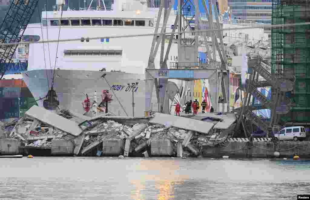 The collapsed control tower is seen at Genoa's port harbor, Italy. At least three people were killed and six injured when a container ship rammed a control tower in the northern Italian port city of Genoa late on May 7, 2013, a port official quoted on local television said.