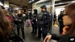 New York City Police Department Transit officers patrol a Times Square subway platform, in New York, March 22, 2016. (AP Photo/Richard Drew)