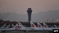 Air China planes are seen on the tarmac at Beijing Capital Airport in Beijing amid the ongoing COVID-19 coronavirus outbreak on March 13, 2020. - China reported just eight cases of the coronavirus on March 13, with no new domestic infections outside the e