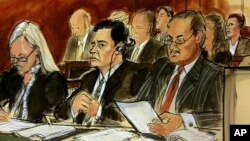 In this courtroom sketch, Mehmet Hakan Atilla, second from left, listens to the judge during his sentencing, flanked by his attorneys Cathy Fleming, left, and Victor Rocco, May 16, 2018, in New York. Atilla's wife, upper right in the sketch, also listens to the proceedings.