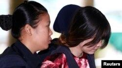Nghi phạm Đoàn Thị Hương bị áp giải đến phiên tòa tại Malaysia ngày 22/1/2018.