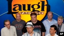 FILE - A group of comedians are seen at the Hollywood Laugh Factory.