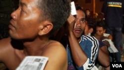 Pekerja migran ilegal asal Indonesia menunggu dideportasi dari Malaysia tahun 2005 silam. IOM merekomendasi pemerintah untuk membuat berbagai kebijakan guna mengatasi masalah kesehatan migran (foto:dok).