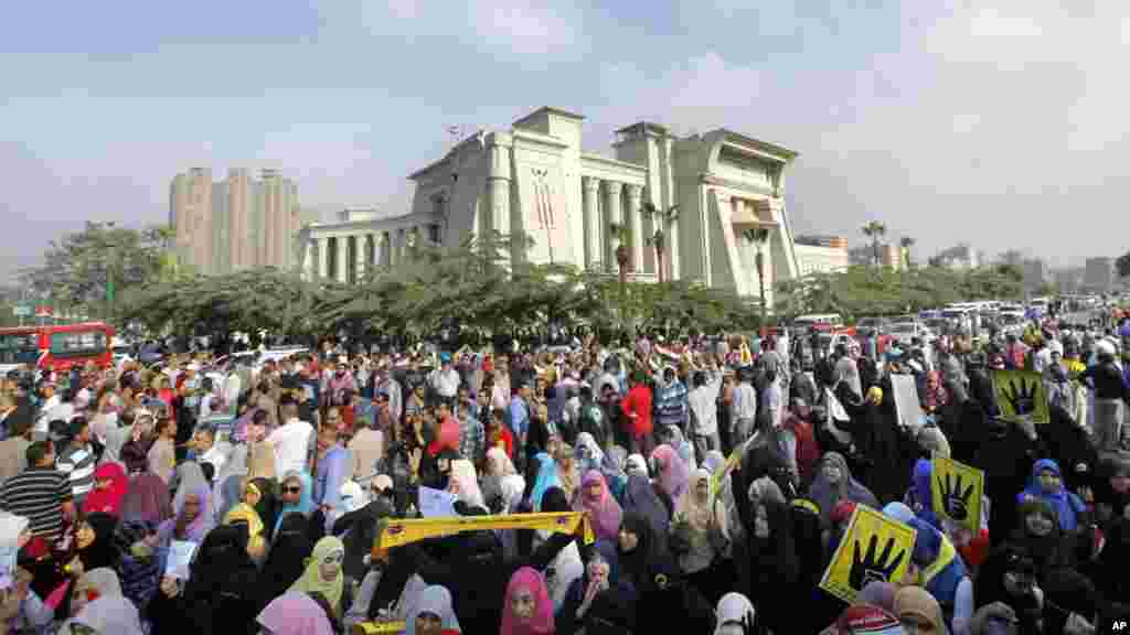 Supporters of Egypt's ousted President Mohammed Morsi protest Morsi's trial in front of the supreme constitutional court in Cairo, Egypt, Nov. 4, 2013.