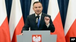 Polish President Andrzej Duda announces his decision to sign a legislation penalizing certain statements about the Holocaust, in Warsaw, Poland, Feb. 6, 2018. Duda said that he will also ask the constitutional court to make final ruling on the disputed Holocaust speech bill.