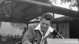 President Ronald Reagan signs a major tax cut bill at his ranch near Santa Barbara, California