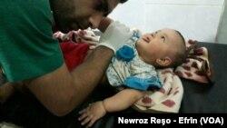 Zarokê birîndar li Efrînê, yek ji qûrabniyên topbaran Artêşa Tirk