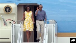 President Barack Obama and first lady Michelle Obama arrive at Cape Cod Coast Guard Station in Bourne, Mass., Aug. 10, 2013.