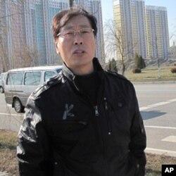 丹东市外办副主任焦石