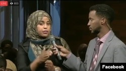 "A moderator, right, and participant in the VOA Somali service's ""Mogadishu-Minnesota"" town hall meeting are seen in a screen grab from its Facebook stream."