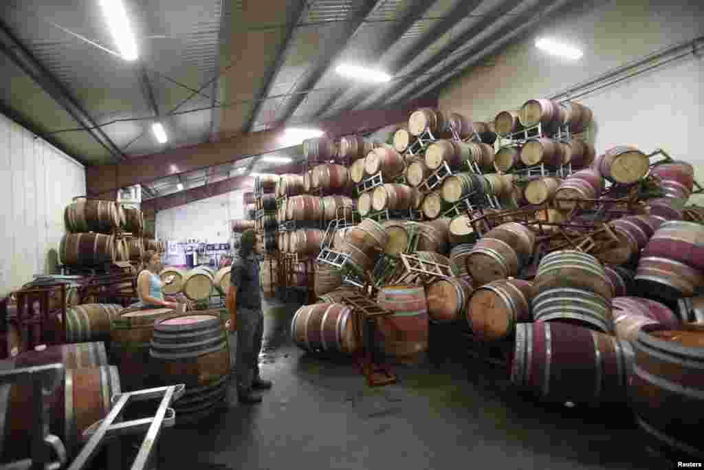 Andrew Brooks, associate winemaker of Bouchaine Vineyards, surveys fallen wine barrels after a 6.0 earthquake in Napa, California, Aug. 24, 2014.