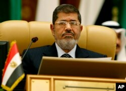 FILE - Egypt's first freely elected civilian President Mohamed Morsi attends the third session of the Arab Economic Summit, in Riyadh, Saudi Arabia, Jan. 21, 2013.
