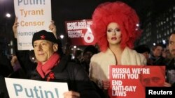 Human rights activist Peter Tatchell (L) protests against Russia's anti-gay stance outside Downing Street, central London February 5, 2014. The protest was held as part of Global Speakout for Russia, which is taking place in more than 30 cities across the