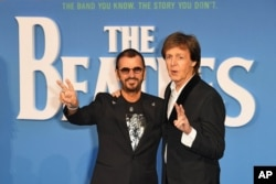 "FILE - Ringo Starr, left, and Paul McCartney at the London premiere of ""The Beatles: Eight Days A Week - The Touring Years,"" Sept. 15, 2016."