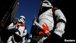 FILE - People dressed as Stormtroopers from Star Wars Rogue One walk in Times Square on Christmas Day in Manhattan, New York City, Dec. 25, 2016.