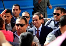 Presidential hopeful Abdel Fattah el-Sissi arrives to a polling site to cast his ballot on the first day of voting in Cairo, Egypt, May 26, 2014.