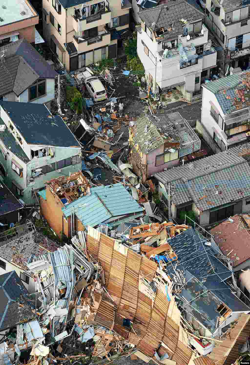 An aerial view shows damaged houses caused by what seemed to be a tornado in Koshigaya, north of Tokyo.