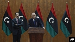 Libya's Prime Minister designate Abdurrahim El-Keib (R) and Abdul Hafez Goga, spokesman for the NTC attend a news conference in Tripoli, November 22, 2011.