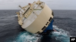 """In this photo taken on Thursday, Jan. 28, 2016 and provided by the Prefecture Maritime Atlantique on Jan. 29, 2016, the cargo ship """"Moderm Express"""" is pictured drifting off the coast of France."""