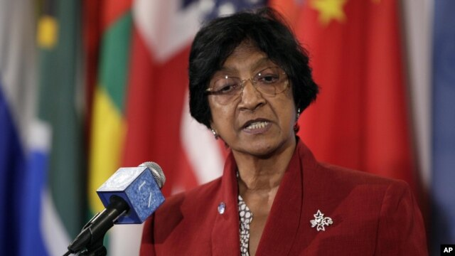 United Nations High Commissioner for Human Rights Navi Pillay answers reporter's questions during a recess of Security Council consultations at the UN headquarters in New York, July 2, 2012.
