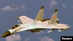 Un avion de combat J-11 chinois, le 19 août 2014. (Photo d'illustration)
