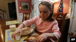 Elizabeth White has a peanut allergy, mixes peanut powder with a fruit roll-up to buildup her tolerance, December 21, 2006.
