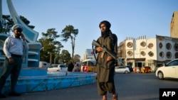 A Taliban fighter patrols along a street in Herat, September 19, 2021.